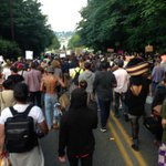 The rally was moving to Olympia City Hall. #Q13FOX http://t.co/nm6yWehUgN