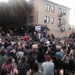 Crowd sits at intersection of Columbia and 4th Ave. #OlympiaShooting http://t.co/LalDxm76SQ