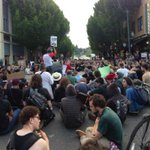 Marchers are doing a sit in on the corner of 4th and Columbia. #Q13FOX http://t.co/vp2q1PRWWG