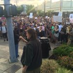 Group protesting the shooting of 2 men by police arrives at #Olympia City Hall. @KIRO7Seattle http://t.co/JPxXzB2Ctc