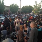 Protestors now sitting down in the street right in front of Olympia City Hall. #liveonkomo http://t.co/Go6tMjsakp