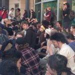 Crowd now sitting outside police dept, say theyre prepared to be here all night. #OlympiaShooting #Q13Fox http://t.co/qrnydBq4E5