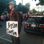 #Olympia protest returns downtown. Sign for the 2 men shot by police earlier today. http://t.co/xLqiNcihEl