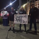 Three people outside police department in #Olympia to support police after #OlympiaShooting. @KIRO7Seattle http://t.co/7nkDzGfjS5