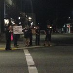 Small group of people has gathered in front of Olympia City Hall in support of Olympia Police. #liveonkomo http://t.co/rk8kUdIfSt