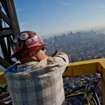 The view from the roof of @OneWorldNYC as a worker takes in the view just after the spire was installed. #NYC http://t.co/4eE3g7Ufus