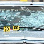 All bullets fired went into this car. Not one bullet was fired from inside of it. The two people in car were unarmed. http://t.co/Trgbtr7VOM
