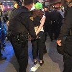 Green hat. Notepad of arrestees on ground. Cops definitely arresting legal observers. #BreloVerdict via @@MegDShaw: http://t.co/nOEC3BjuHu