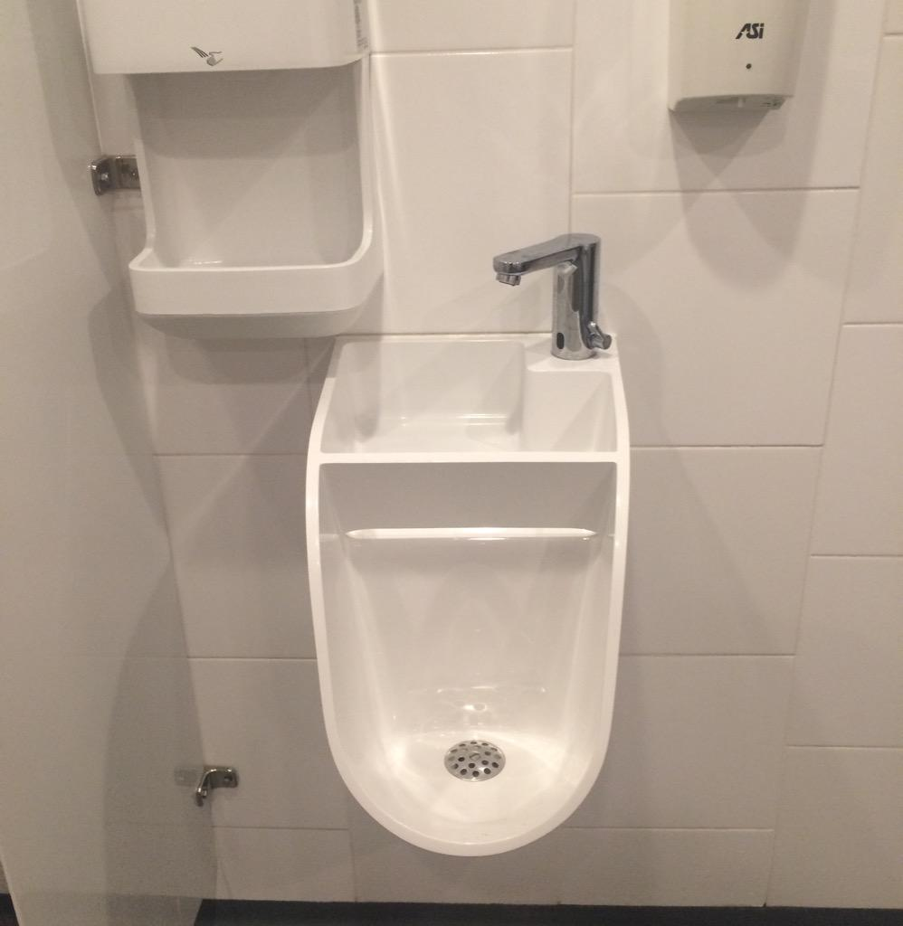 The men's bathroom of the future is now: this bar has urinal-and-sinks in one. http://t.co/1TNf7bi0Ot