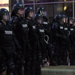 State police appear on Euclid Ave. in full riot gear. (Marvin Fong / The Plain Dealer) http://t.co/9v2uVgfdW6