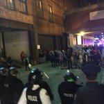 """Police with full riot gear chant """"move back"""" as they knock on shields and approach protesters. http://t.co/46HaSu58DB"""