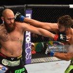 An incredible heavyweight fight as @AndreiArlovski beats his former roommate @travisbrowneMMA. Unreal! #UFC187 http://t.co/dA8jziMseo