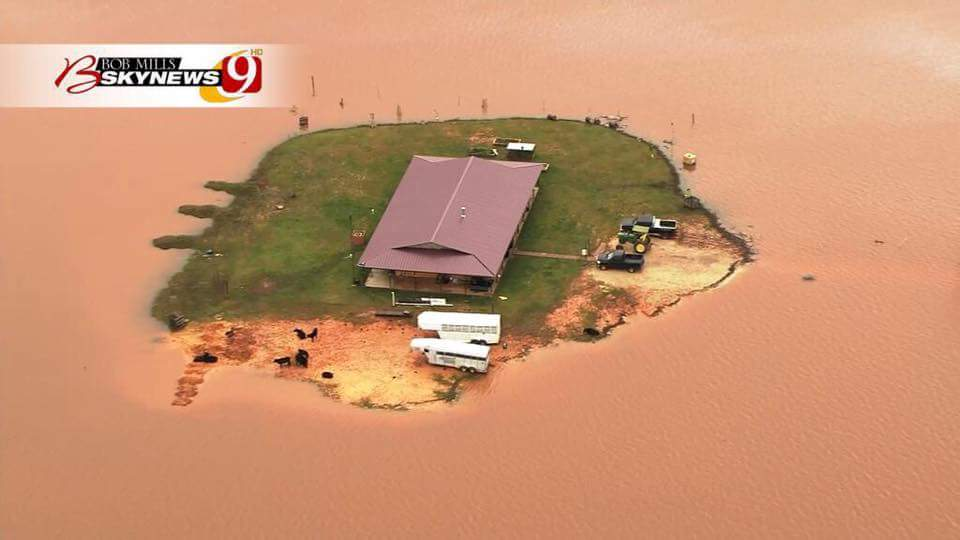 Wow.  Flood water surrounding a home near Shawnee, OK http://t.co/yXveOATjFa