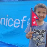 A young boy, proudly holding the #Nepal flag, at one of our child-friendly safe spaces. #NepalEarthquake http://t.co/JHMPHPoVUd