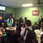 Hillary Clinton speaks with a graduation party at Kikis Chicken and Waffles in Columbia, SC. http://t.co/8PYv9Lz2mq