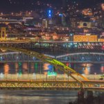 Cars rush over bridges as they glow and stack on top of each in front of the South Side of #Pittsburgh at night http://t.co/QGD8by2hwV