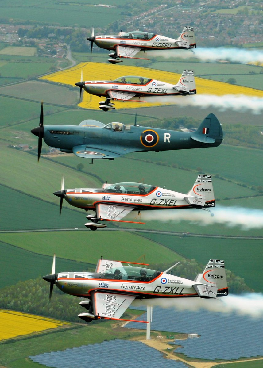 Here's a few shots of us in our new livery in flight with a Spitfire... @BelcomCables @aerobytes @Aerobility @RAFBF http://t.co/jBn07OExqy