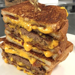 The Wisconsin @TimberRattlers are selling about 35 Bacon Grilled Cheese Burgers ($10) a game #NationalBurgerDay http://t.co/NnDkjsDdKF