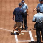 Auburns Clint Myers greets the umpires at home plate, his lineup card in hand, at the College World Series http://t.co/6tRg30yatg