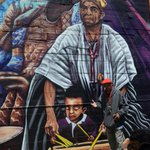 was checking out the latest part of awesome Alice St. mural, and met Tacuma King whos pictured in it #Oakland http://t.co/2AYCH9nwK3