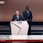 Issa Hayatou standing behind Blatter. Literally his bodyguard as well as it is metaphoric. #FIFACongress http://t.co/xQ84IMIwug