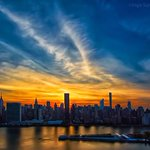 Manhattanhenge sunset is pretty but a little coy tonight. #NYC #Manhattanhenge2015 http://t.co/vwhPNvmlQ1