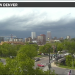 Storm clouds rolling into #Denver. Brief downpours, small hail, gusty winds all on the way.#9wx #cowx http://t.co/b1oKm0VCvl