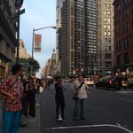 There are literally thousands of people in the streets, blocking traffic, to get photos of #ManhattanHenge. http://t.co/jY5H8ch1nL