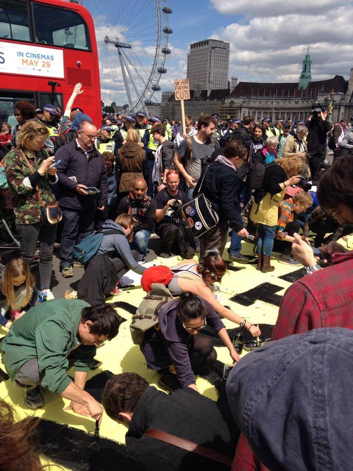 Activists blocking Westminster Bridge right now @UKuncut @pplsassembly @SistersUncut http://t.co/oNyq19L3XO