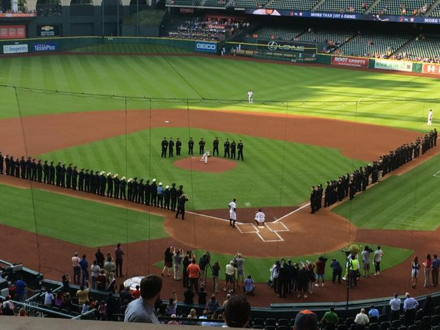 Approx 80 police officers watch as Tyler Martin, son of Richard Martin, killed in line of duty 5/18, throws 1st pitch http://t.co/K6Zzo0f2wT