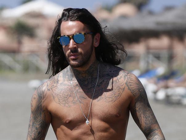 Who's this? TOWIE's newest hunk joins co-stars at the beach in Marbella!