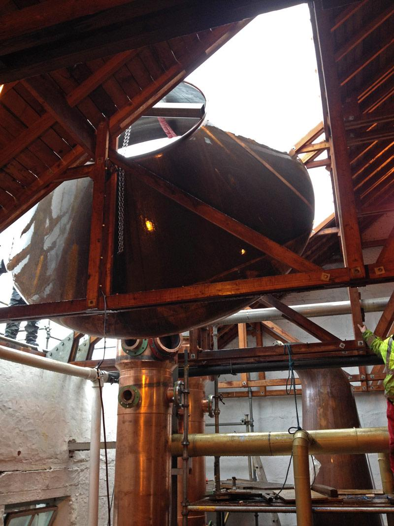 New wash still shoulders being lowered into place through the Still House roof this morning. http://t.co/nSLV44fLGD