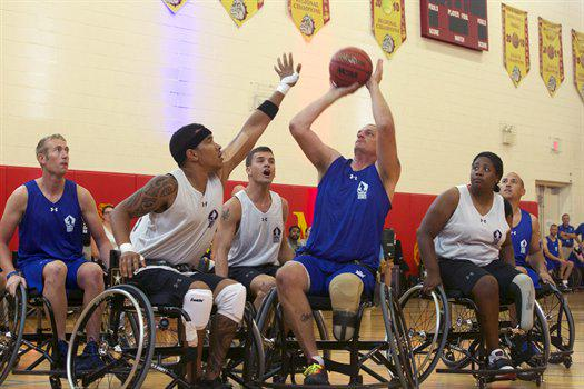 Athletes compete in Wheelchair Basketball during the 2015 DoD @WarriorGames