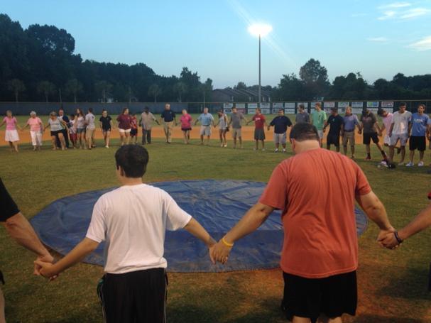 Shot of the prayer circle from CSU baseball vigil http://t.co/gDisw7eg9W