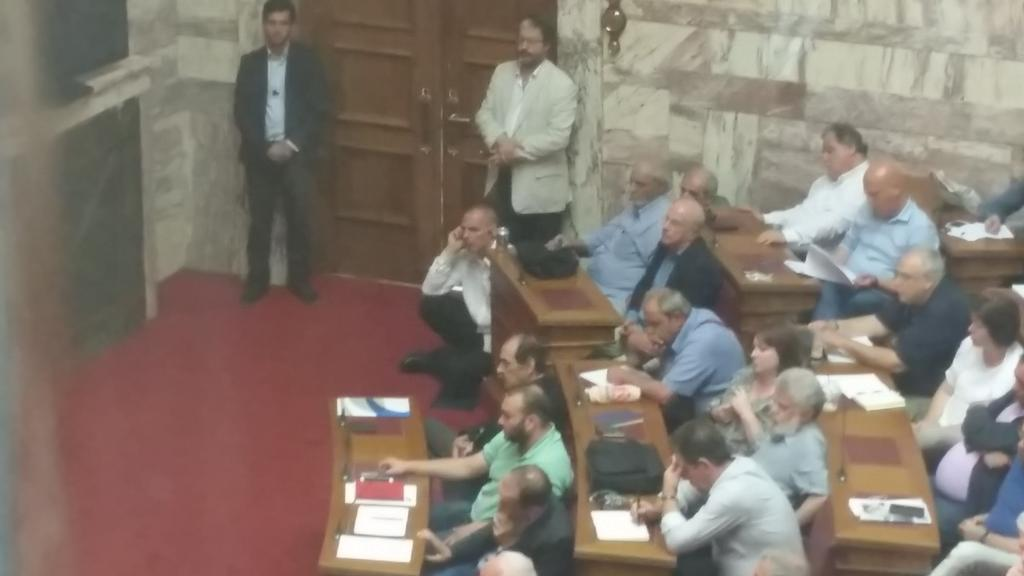 @yanisvaroufakis sitting on the stairs while listening to @PrimeministerGR #Greece http://t.co/YJM72g4zlE