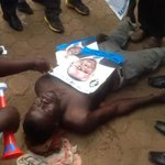 Fdc party member Godfrey Bbale, shot by Uganda Police, while carrying my poster to Fdc flag bearer nominations! http://t.co/jz0iAsO8gN