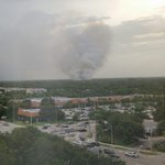 Photo of PBG brush fire from the 10th floor of Celedinas Insurance Building at PGA and Military [Photo: Sarah Roth] http://t.co/b8ArILTVlK