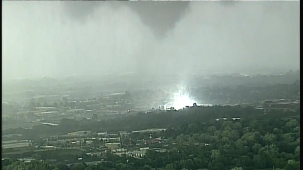 Andrea Butera (@AndreaButera): Here's a screen grab of the #tornado in Jackson County, MO just a few min ago. Ctsy of @41ActionNews (KSHB) #MOwx http://t.co/Tyvqk6UeMP