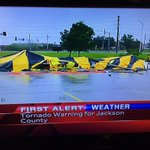 Tent & semi overturned. Lees Summit North HS.  From @EliKMBC StormTracker 9 7:08pm http://t.co/i9Xk5C9kXs