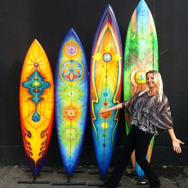 Me with a few super awesome painted surfboards by @DrewBrophy !  #Sacredgeometry #SurfboardArt http://t.co/6qg4ILRj9c