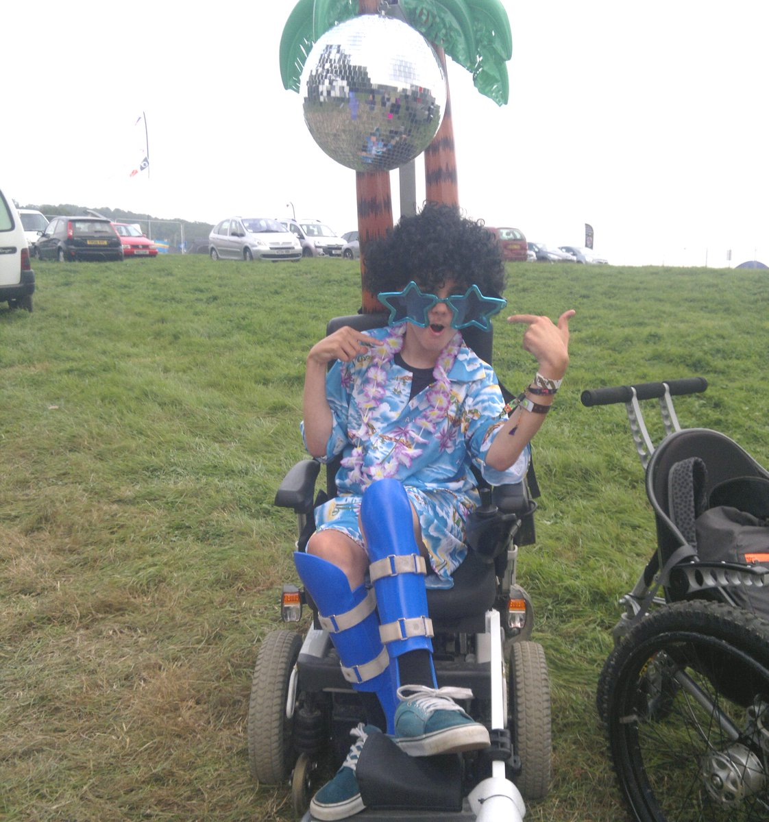 It's #Glastonbury today & we love this pic of James who went to a festival with a disco ball on his #wheelchair! http://t.co/ia0rOHKrJf