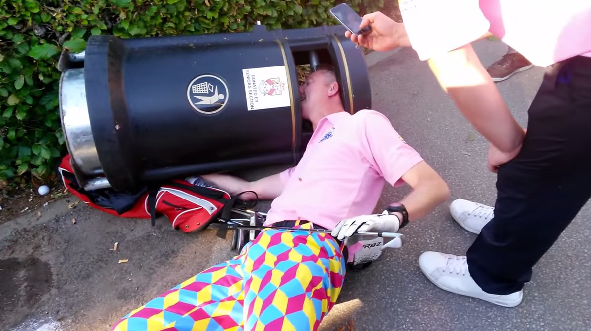 Qbert Drunk Golfer Gets Head Stuck In Trash Can While Wearing Q