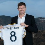 This looks so weird...RT @LAGalaxy: Welcome to Los Angeles, Steven Gerrard! #GR8NESS http://t.co/1m7Gj0Fj2h