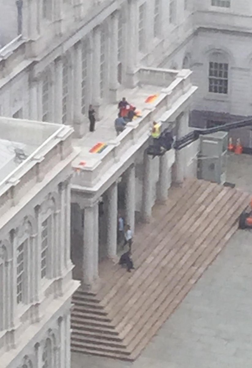 Rainbow flags about to be hung from New York City Hall. http://t.co/f005rS7evp