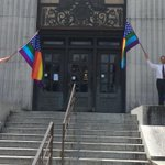 Flags outside Hinds County Courthouse resembling the American flag with rainbows replacing the red and white stripes http://t.co/L8ATt6voRp