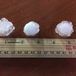"""Hail at the WXOW Studio between an inch and 1.50"""" (quarter up to ping pong balls) and hail covered parking lot http://t.co/nbHmrCTEpc"""