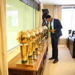 The rookies getting acquainted with the hardware in @JeanieBuss office http://t.co/EFZ08rFs9n
