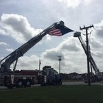 Entrance to church parking lot with flag flying atop Wilco ladder trucks. http://t.co/xsICA5Iy14