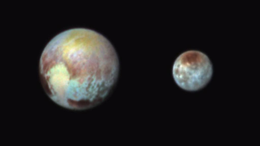"Now we're talking! ""@rebeccamorelle: And here you go...Pluto and Charon in full on colour... #PlutoFlyby http://t.co/hdavsZPyLS"""