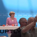 """""""#Oxi!"""" Merkel interrupted by Greek solidarity protesters http://t.co/A4HHPBTGJY #GreeceCrisis http://t.co/cznTMWmet9"""